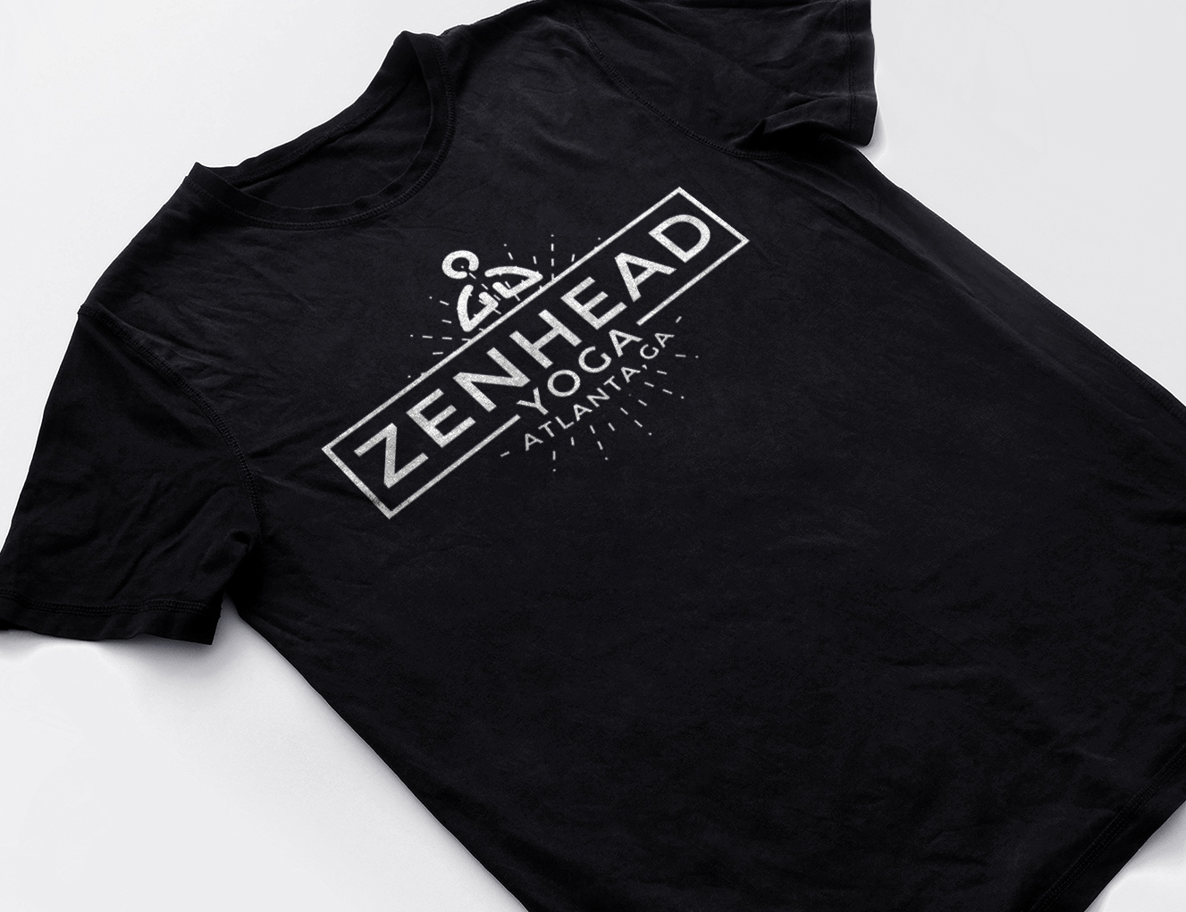 Zenhead yoga studio logo on black t-shirt